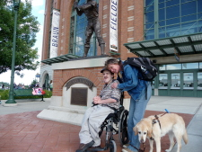 Gus, Beth's Seeing Eye dog Hanni and Beth--in front of the Hank Aaron statue outside Miller Park on a  driving vacation to Milwaukee.