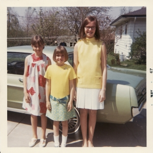 That's my sister Bev, me in the middle, and my sister Marilee in front of our older sister Cheryl's 1967 Mustang, back in our David/Bacharach days.