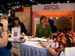 Signing books at the ASPCA booth.