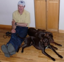 That's Greg with his and Lois' dogs Gamma and Griffin.