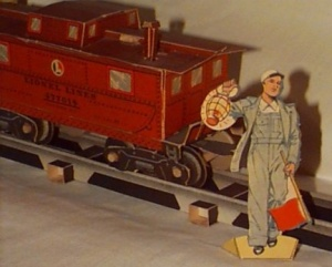 An assembled cardboard Lionel train car (and action figure).
