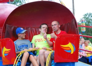 Bobby Ladwig -- a staff member at Gus' house -- took Gus and other residents to the local carnival last year. That's Bobby's son on the left.