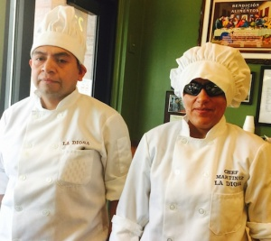 That's Chef Laura on the right, alongside her husband and fellow restaurateur Mauri.